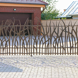 A wrought iron gate inspired by nature - A grass
