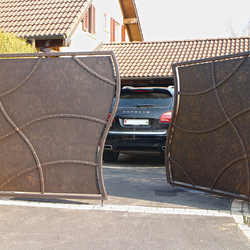 A wrought iron gate - privacy as art - A modern gate