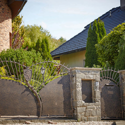A hand forged fence and gate with sheet metal - A luxury fence and gate