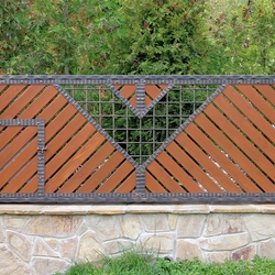 A wrought iron gate - wood - metal, harmony of materials - A modern gate