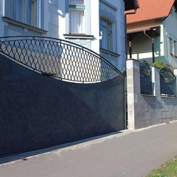 A wrought iron fence - metal and wrought iron combination