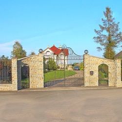 An exclusive wrought iron gate and fence in a family villa - A historic gate and fence